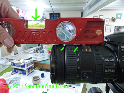 Using the bubble level on the top of the lens is a challenge because of the grip and changes in the surface.