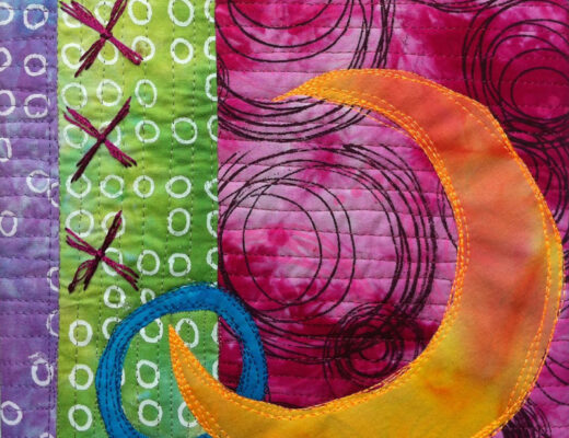 textile art with orange crescent surrounded by pink, green, and purple circles and embroidered X
