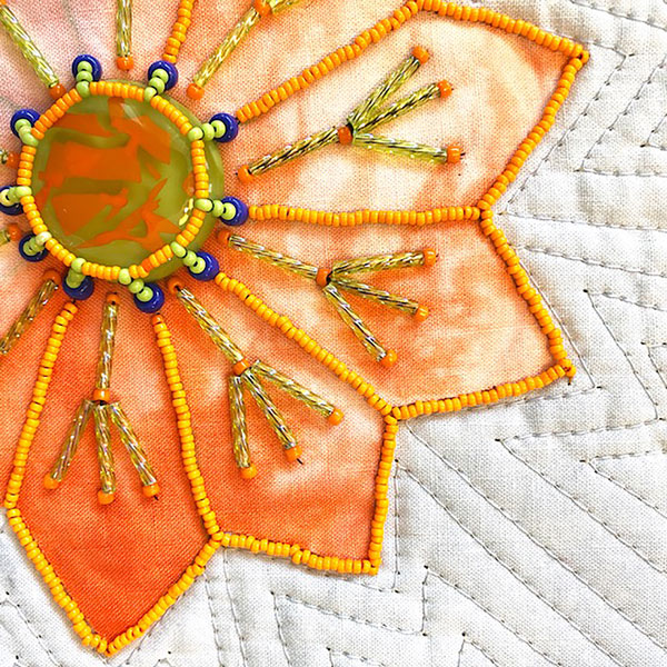 beaded orange fabric flower