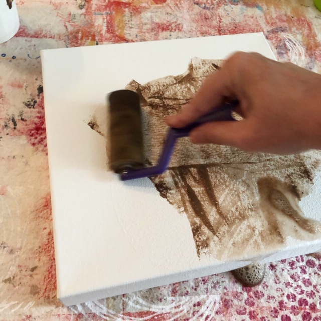 Adding paint to molding paste printed canvas