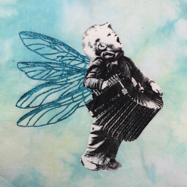 boy playing accordion with dragonfly wings