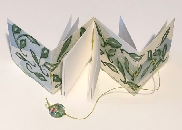 tiny accordion book with leaves painted not eh cover
