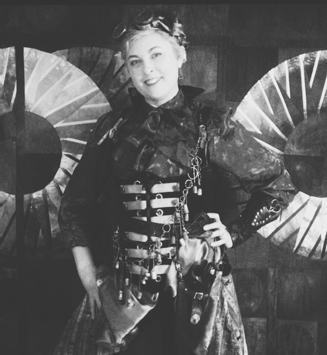 black and white picture of lyric kinard dressed up as a steam punk seamstress